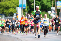 A man in front of a large group of runners in ASICS Stockholm Ma Royalty Free Stock Images