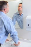 Man in front mirror Royalty Free Stock Photography
