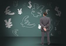 man in front of money on wall Stock Images