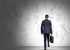 man in front of money on wall Royalty Free Stock Photos