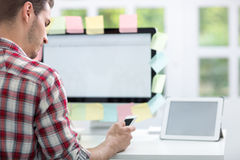 Man front of monitor with notes on it Stock Photos