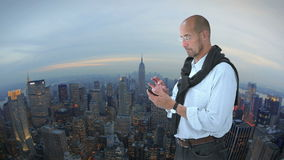 Man in front of New York. With green screen and alpha matte stock video