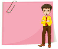 A man in front of a pink empty template with a paperclip Stock Photos
