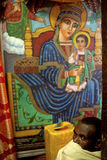 A man in front of a religious painting, Ethiopia Stock Images