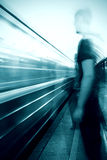 Man in front of a subway train. Blur background Royalty Free Stock Photo