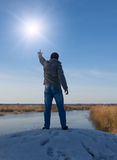 Man in front of the sun Stock Images