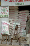Man in front of there shop selling grain. Royalty Free Stock Photos