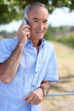 Man in front of village Stock Photography