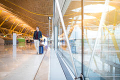 Man front walking at the airport using mobile phone Royalty Free Stock Photos
