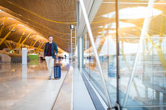 Man front walking at the airport using mobile phone Stock Photography