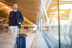 Man front walking at the airport using mobile phone Royalty Free Stock Images