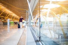Man front walking at the airport using mobile phone Stock Photos