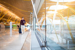 Man front walking at the airport using mobile phone Royalty Free Stock Image