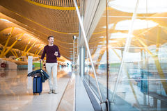 Man front walking at the airport using mobile phone Royalty Free Stock Photography