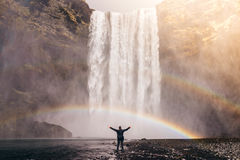 Man in front of waterfall Stock Images