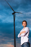 Man in front of windmill and sky Royalty Free Stock Image