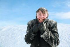 Man froze and hides head in collar of overcoat. Young man froze and hides head in collar of winter overcoat stock image