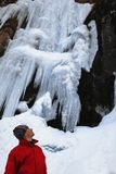 Man and frozen waterfall Stock Images