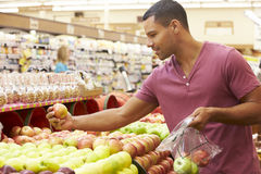 Man At Fruit Counter In Supermarket Stock Images