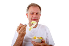 Man with a fruit salad Royalty Free Stock Photo
