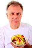 Man with a fruit salad Stock Photos
