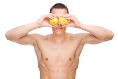 Man with fruits. Full isolated studio picture from a young naked man with some fruit Royalty Free Stock Photo
