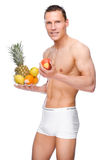 Man with fruits. Full isolated studio picture from a young naked man with some fruit Royalty Free Stock Image