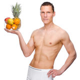 Man with fruits. Full isolated studio picture from a young naked man with some fruit Stock Photography