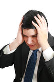 Man frustrated with hands on his head. Stock Photos