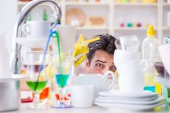 The man frustrated at having to wash dishes Royalty Free Stock Image