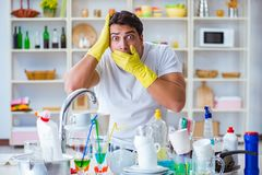 The man frustrated at having to wash dishes Royalty Free Stock Photography