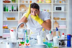 The man frustrated at having to wash dishes Royalty Free Stock Photo