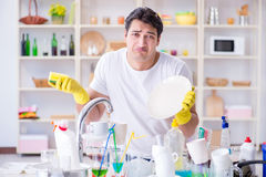 The man frustrated at having to wash dishes Stock Photography