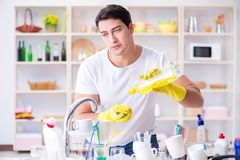 The man frustrated at having to wash dishes Royalty Free Stock Images