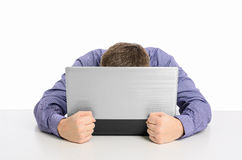 Man frustrated with his laptop computer Royalty Free Stock Photo
