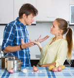 Man and frustrated housewife having bad argument Stock Photo