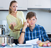 Man and frustrated housewife having bad argument Stock Image