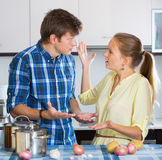 Man and frustrated housewife having bad argument Royalty Free Stock Photo
