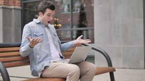 Man frustrated by results, sitting outside office stock video footage