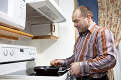 Man frying eggs Royalty Free Stock Photo