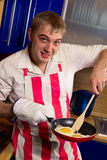 Man frying eggs Royalty Free Stock Photography
