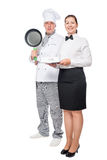 Man with a frying pan and cook woman waiter with a tray. Man with a frying pan and cook women waiter with a tray on a white background Stock Photography