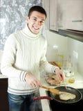 Man frying  steak of fish Royalty Free Stock Image