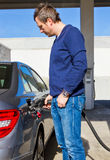 Man on a fuel station Royalty Free Stock Images