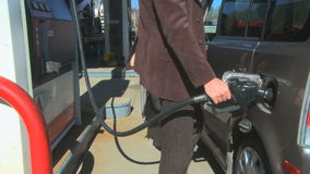 A Man is fueling his car with gas. A Man is fueling his car stock footage