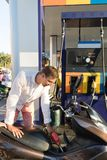 Man Fueling Motorcycle On Station Motorcyclist Petrol Bike. Man Fueling Motorcycle On Station Young Motorcyclist Petrol Bike royalty free stock images