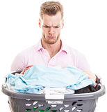 Man with full basket of laundry, isolated Royalty Free Stock Photo