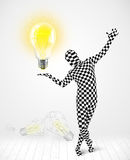 Man in full body with glowing light bulb Stock Photos