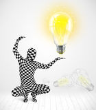Man in full body with glowing light bulb Stock Photo