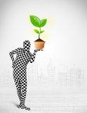 Man in full body suit with eco plant Stock Photography